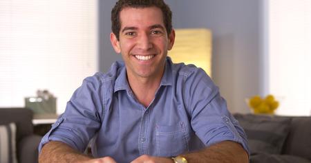 Man happily talking to camera
