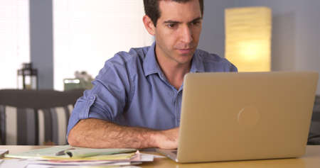 figuring: Man using laptop for online banking