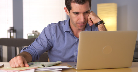 figuring: Man feeling frustrated with bills