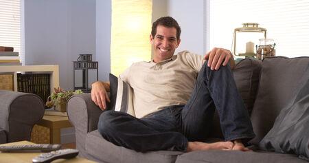 lounging: Man lounging on sofa