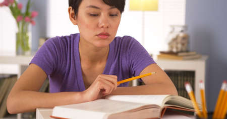 chinese woman: Chinese woman student studying for final exams