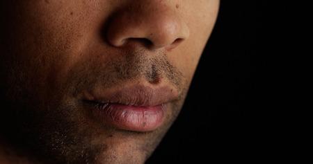 Close up on African mans lips Reklamní fotografie