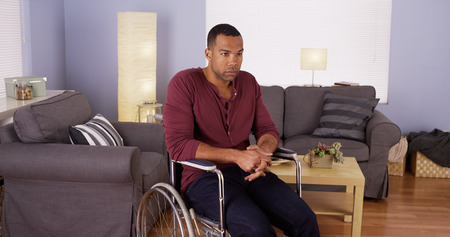 american content: African man sitting in wheelchair looking at camera