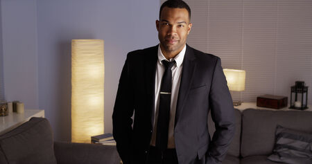 suave: Suave black man standing in suit