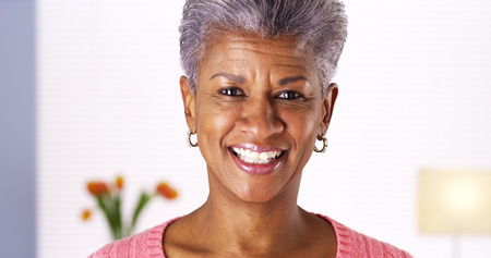 Mature African woman smiling at camera