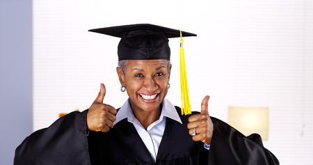 Proud mature African woman graduate Standard-Bild