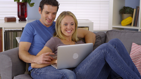 purchase: Couple excited to make a purchase online Stock Photo