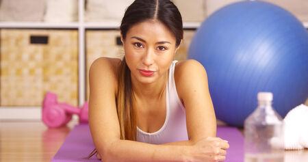 tough woman: Tough Japanese woman resting after workout