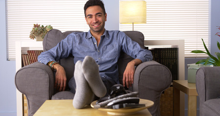 rican: Attractive Latino sitting in his living room