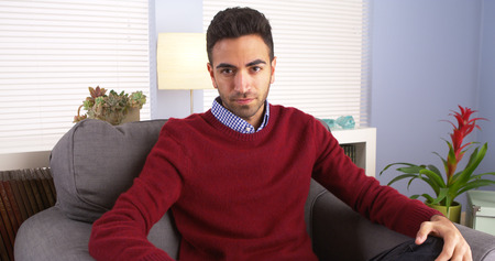 rican: Suave Puerto Rican man sitting in living room