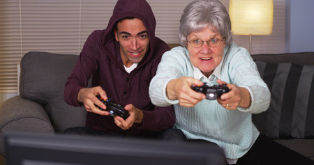 Mexican guy playing video games with grandma