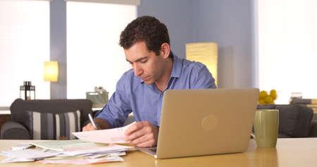 Man doing his taxes at desk