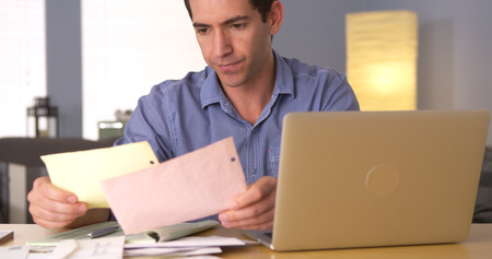 Man feeling frustrated with bills
