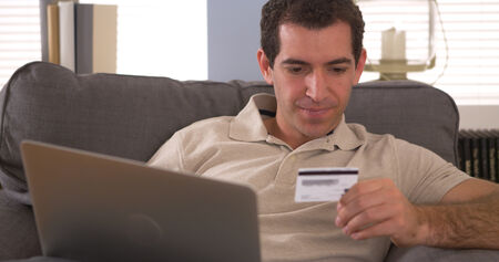purchase: Man making an online purchase with laptop
