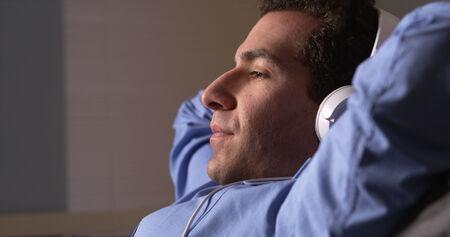 taking a break: Businessman taking a break and listening to music