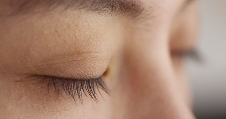closed up: Closeup of Chinese womans eyes