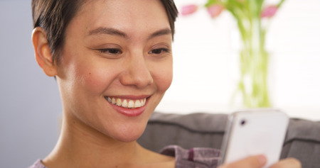 mobile voip: Chinese woman using webcam on smartphone Stock Photo