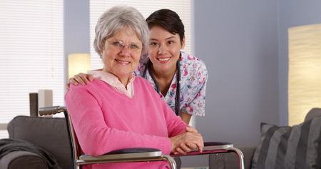 asian old lady: Asian nurse smiling with Elderly patient Stock Photo