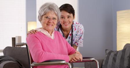 Asian nurse smiling with Elderly patient Archivio Fotografico