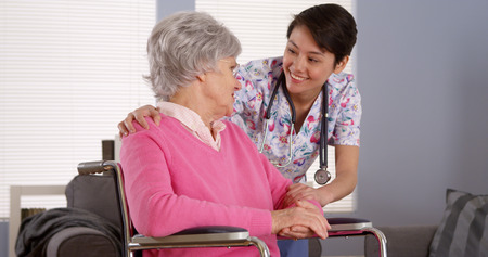 Asian nurse talking with Senior patient