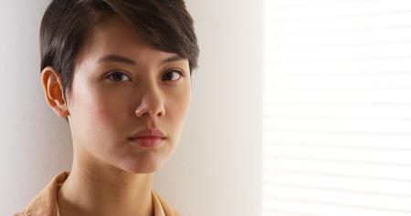 tough woman: Beautiful Asian woman wearing vintage clothes Stock Photo