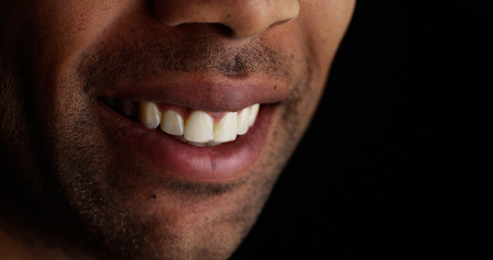 stubble: Close up on black male lips