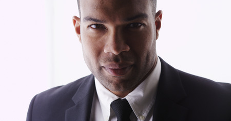 Attractive black man looking at camera wearing suit photo