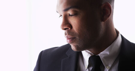 Profile of handsome black man wearing a suit photo