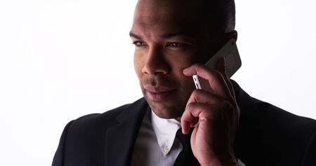 Confident young businessman talking on smartphone photo