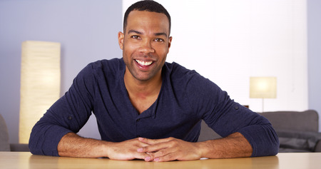 Black man smiling; talking; and saying goodbye Stock Photo