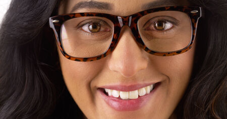 geeky: Geeky Mexican woman smiling and looking at camera Stock Photo
