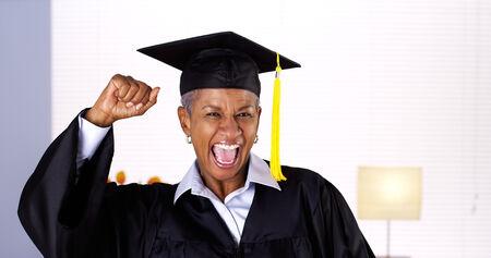 Proud mature African woman graduate Stok Fotoğraf