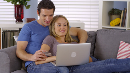 purchase: Couple making a purchase online with laptop
