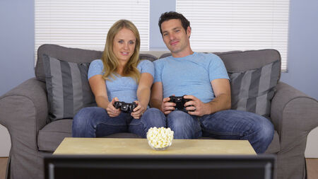 Couple in matching clothes playing video games photo