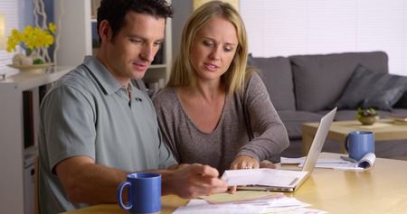 Couple managing their bills Stock Photo