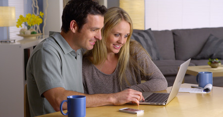 getaways: Couple looking for vacation getaways on laptop