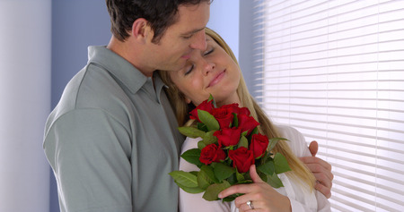 bouqet: Beautiful wife gets surprised with bouqet of roses