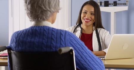 hispanics mexicans: Happy Mexican doctor talking with senior patient
