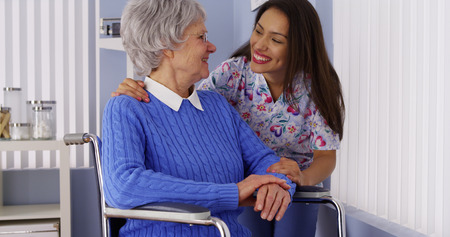 mature mexican: Happy senior woman with friendly Mexican caregiver Stock Photo