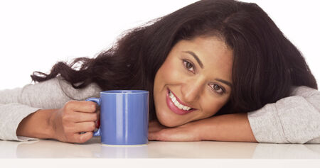 Happy Mexican woman with coffee photo