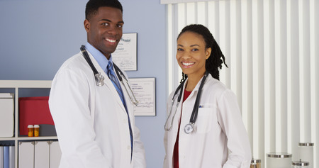 white coats: Confident African American medical professionals in hospital