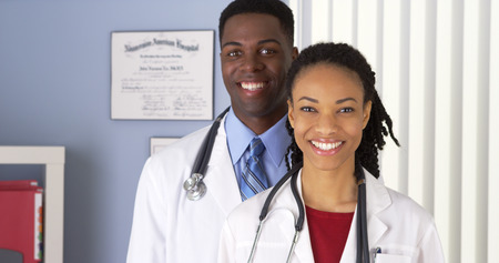 Close up of of smiling African American doctors in Imagens