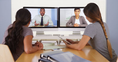 skype: Diverse business colleagues holding a video conference meeting
