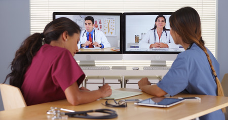 skype: Group of diverse medical doctors video conferencing Stock Photo