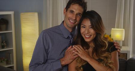 Happy interracial couple smiling at camera photo