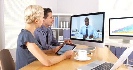 skype: African businessman remotely having a discussion with colleagues Stock Photo