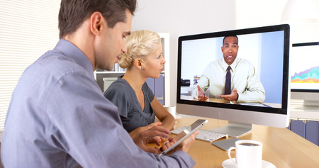skype: Business colleagues having a video conference Stock Photo