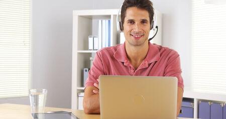teleconference: Attractive company representative sititng at desk Stock Photo
