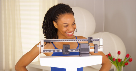 sliding scale: African woman feeling very proud of herself