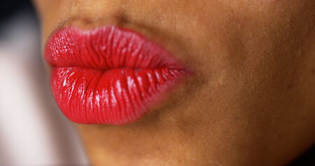 puckering lips: Closeup of woman puckering lips Stock Photo